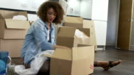 Woman Packing Boxes Ready For House Move video
