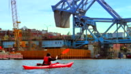 4K Woman Paddles her Kayak up to the Johnson Street Bridge in Victoria BC video