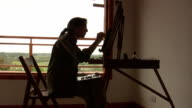 Woman painting backligting video
