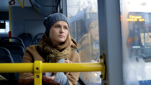 Woman passenger looking out bus window video