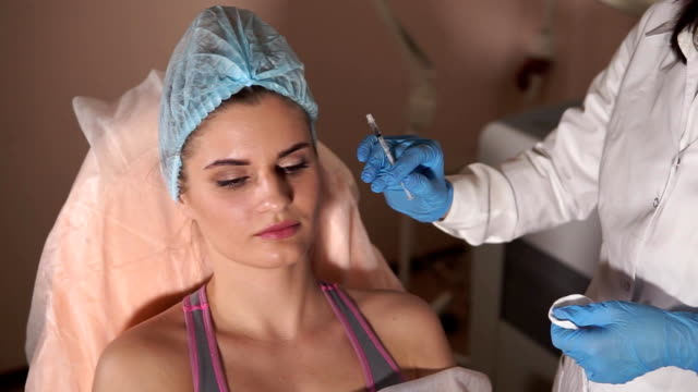Woman patient and cosmetologist. Beauty injection. video