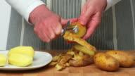 Woman Peeling Potatos Close-up (4:2:2@100 Mb/s) video