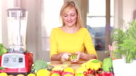 Woman peeling skin off kiwifruit video
