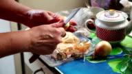 Woman peels onions video