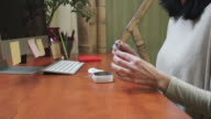 Woman performing a glucose blood test on herself video