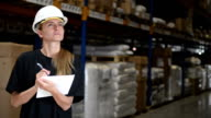 Woman performs control in warehouse video