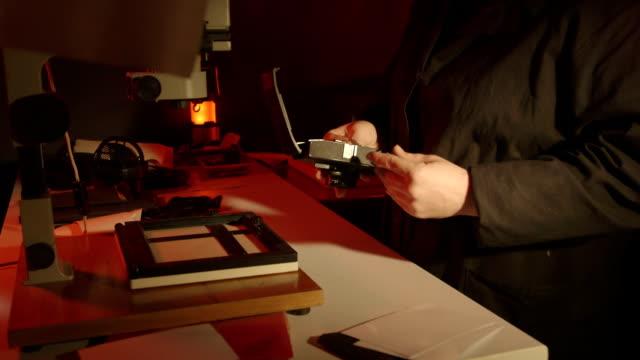 Woman photographer loads new film into her 35mm Lomo Smena Symbol camera video