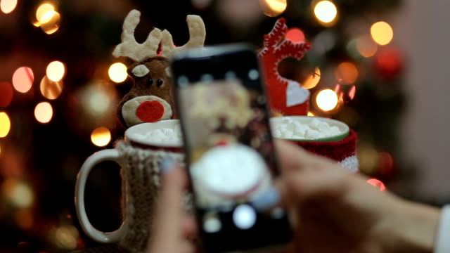 Woman photographing christmas drinks and christmas decorations. video