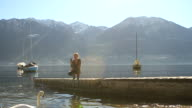 Woman photographings beautiful lake video