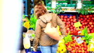 HD: Woman Picking Up Vegetables In Grocery Store video
