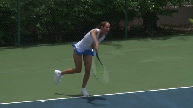 Woman playing a series of tennis shots video