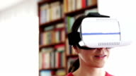 Woman playing at home with Virtual Reality Headset video