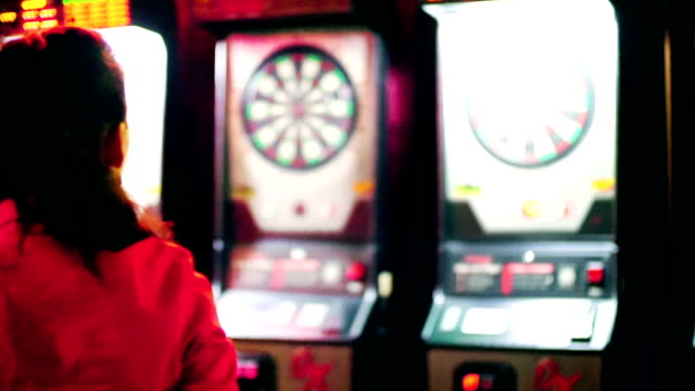 Woman playing darts. video