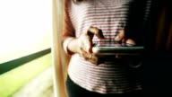 Woman playing mobile phone, Slow motion video