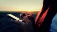 woman playing mobile phone video