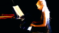 Woman playing piano. video