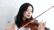 woman playing violin, 4K video