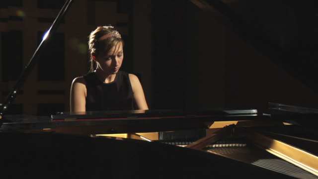 HD: Woman plays the piano video