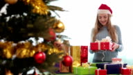 woman posing with Christmas gifts video