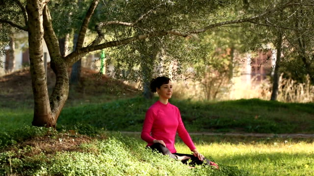 woman practicing meditation outdoors video
