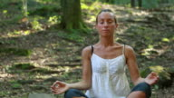 Woman practicing yoga in nature video
