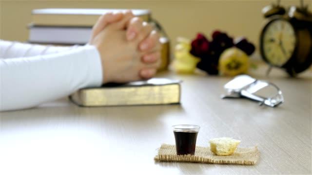 Woman praying before taking communion video