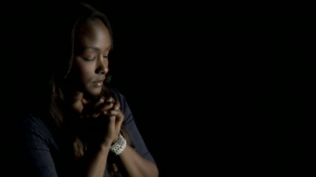 HD Woman Praying in Darkness video