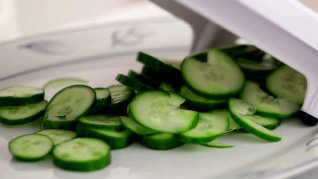 Woman prepares salad with the help of vegetable cutter video