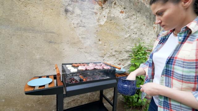 Woman preparing barbecue. video