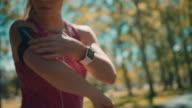 Woman preparing for jogging video
