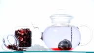 TL Woman preparing red Hibiscus tea video