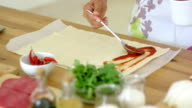 Woman preparing traditional homemade pizza video