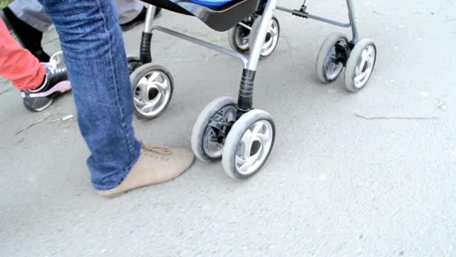Woman Pushing Baby Stroller video