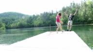 Woman Pushing Man In lake video