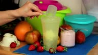 Woman put protein in shaker video