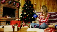 Woman puts presents under the Christmas tree video