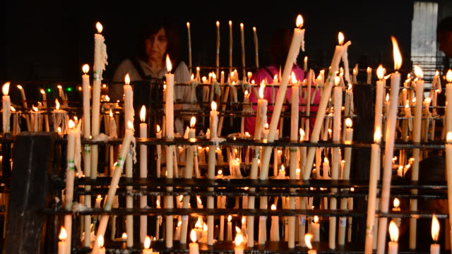 Woman putting candles in candlestick video