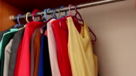 Woman putting her closet new clothes video