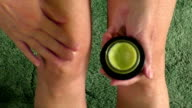 Woman putting ointment cream on bad injured knee video