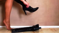 Woman Putting on Black Boots video
