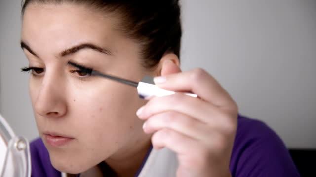 Woman putting on mascara. Close up. video