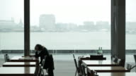 Woman reading a book in a public building, Amsterdam video