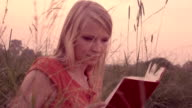 Woman reading a book. video