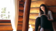 Woman reading in the mountain cabin. video