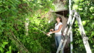 Woman ready to Clear Overgrown Garden video