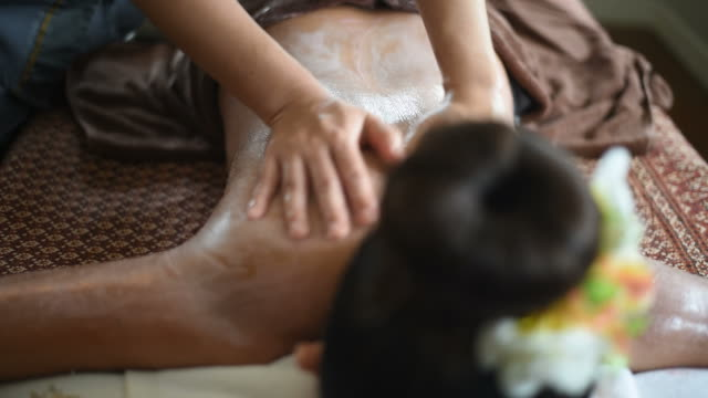 woman receiving scrub body massage at spa salon. video