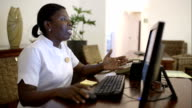 Woman receptionist at spa talking to guest video