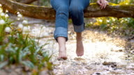 DS SLO MO Woman refreshing her feet in creek video