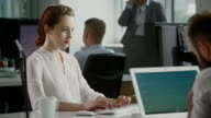 Woman relaxed at work. Office space video