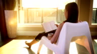 Woman relaxes in freedom at sunset video